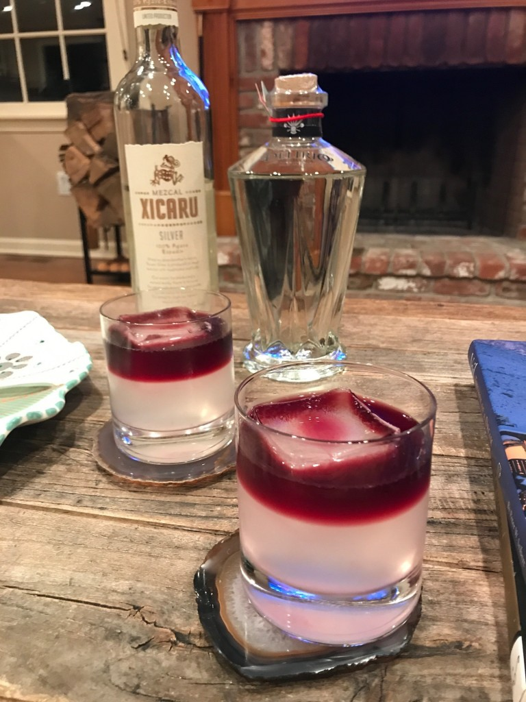 Mezcal cocktail served over a large ice cube