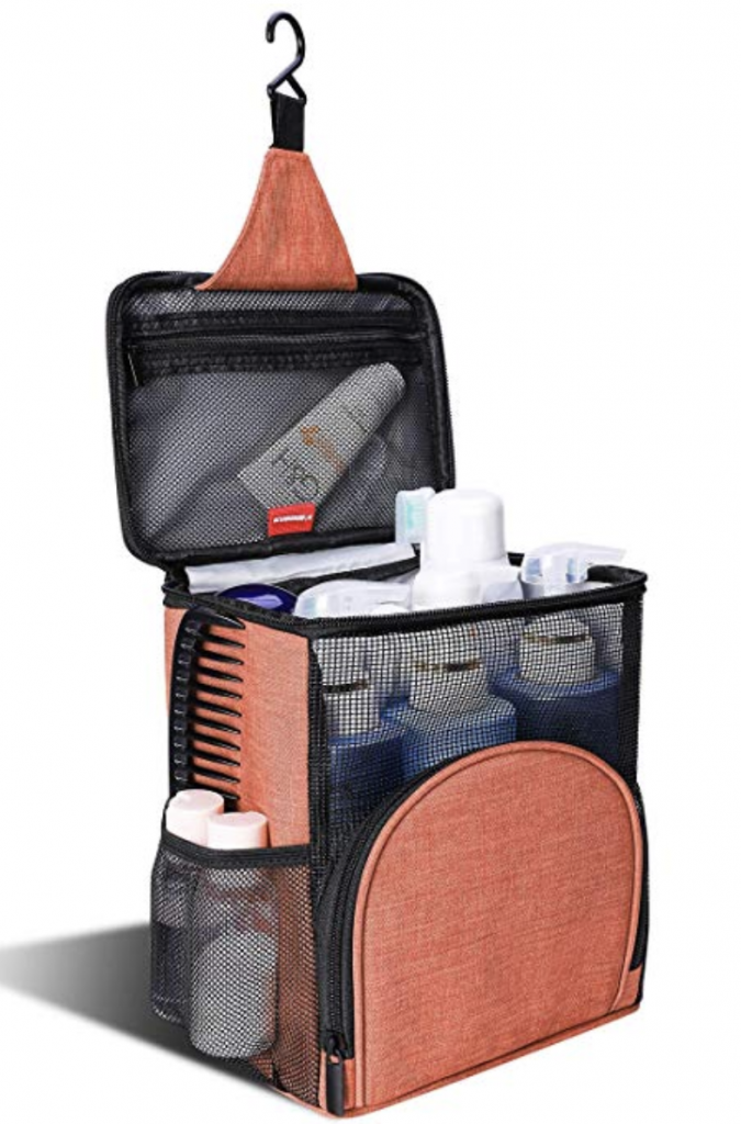 Orange hangable shower caddy filled with sower items like comb, shampoo, conditioner, tooth brush and cream.