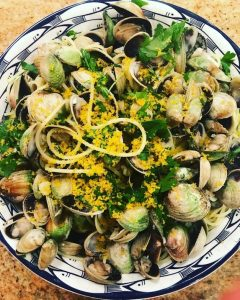 spaghetti with clams and grated yellow bottarga